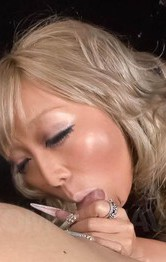 Rina Aina Asian licks cock head before sucking it like a bitch