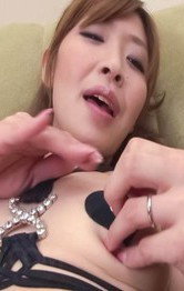 Koda Riri Asian babe fingers her cum dumpster and teases nipples