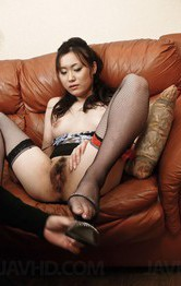 Hitomi Aizawa Asian rubs her hairy twat and has it aroused by man