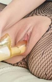 Nami Itoshino rubs her slit and fucks it with dildo through nylon