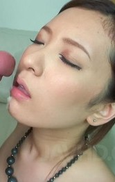Yui Kasuga in fishnets sucks two shlongs till gets cum on lips